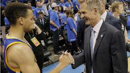 Warriors head coach Steve Kerr congratulates Stephen Curry (30) after the Golden State Warriors defeated the Oklahoma City Thunder 108-101 in Game 6 of the Western Conference Finals at Chesapeake Energy Arena in Oklahoma City, Okla., on Saturday, May 28, 2016.