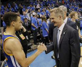 Warriors head coach Steve Kerr congratulates Stephen Curry (30) after the Golden State Warriors defeated the Oklahoma City Thunder 106-101 in Game 6 of the Western Conference Finals at Chesapeake Energy Arena in Oklahoma City, Okla., on Saturday, May 28, 2016.