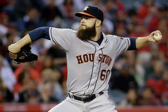 Houston Astros starting pitcher Dallas Keuchel trows against the Los Angeles Angels during the second inning of a baseball game in Anaheim, Calif., Saturday, May 28, 2016. (AP Photo/Chris Carlson)