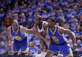 Andre Iguodala (9) and Harrison Barnes (40) box out Serge Ibaka (9) from a rebound in the second half as the Golden State Warriors played the Oklahoma City Thunder in Game 6 of the Western Conference Finals at Chesapeake Energy Arena in Oklahoma City, Okla., on Saturday, May 28, 2016.