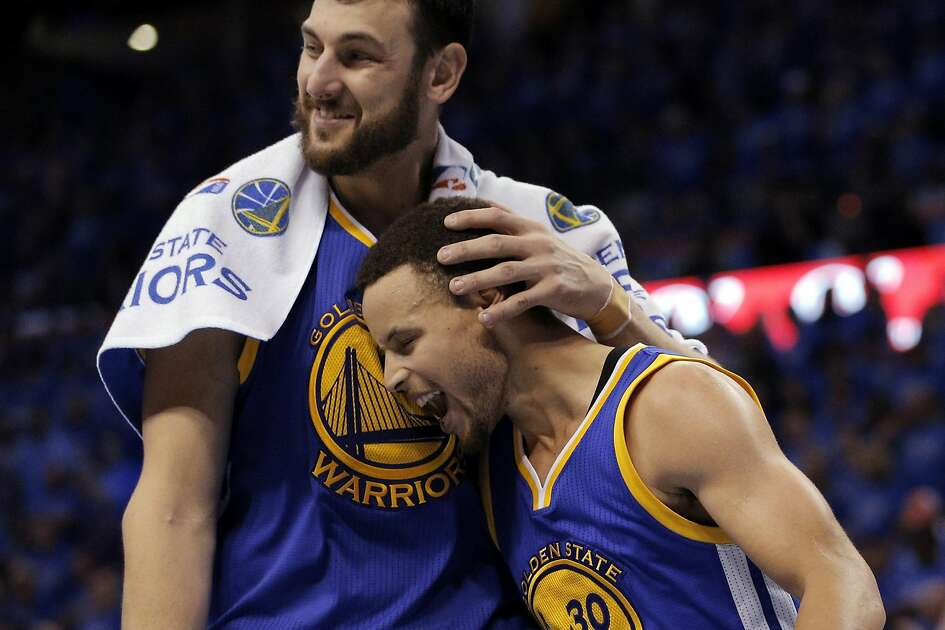 Andrew Bogut (12) gives Stephen Curry (30) a hug in the file seconds of the second half as the Golden State Warriors played the Oklahoma City Thunder in Game 6 of the Western Conference Finals at Chesapeake Energy Arena in Oklahoma City, Okla., on Saturday, May 28, 2016.