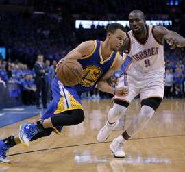 Stephen Curry (30) drives past Serge Ibaka (9) in the second half as the Golden State Warriors played the Oklahoma City Thunder in Game 6 of the Western Conference Finals at Chesapeake Energy Arena in Oklahoma City, Okla., on Saturday, May 28, 2016.