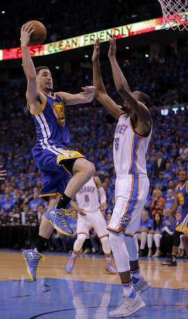 Klay Thompson (11) shoots over Kevin Durant (35) in the second half as the Golden State Warriors played the Oklahoma City Thunder in Game 6 of the Western Conference Finals at Chesapeake Energy Arena in Oklahoma City, Okla., on Saturday, May 28, 2016.