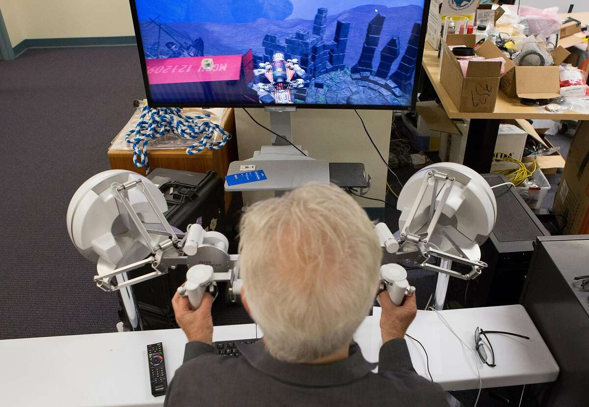 Stanford Professor Oussama Khatib demonstrates how to use the haptic devices that control OceanOne.