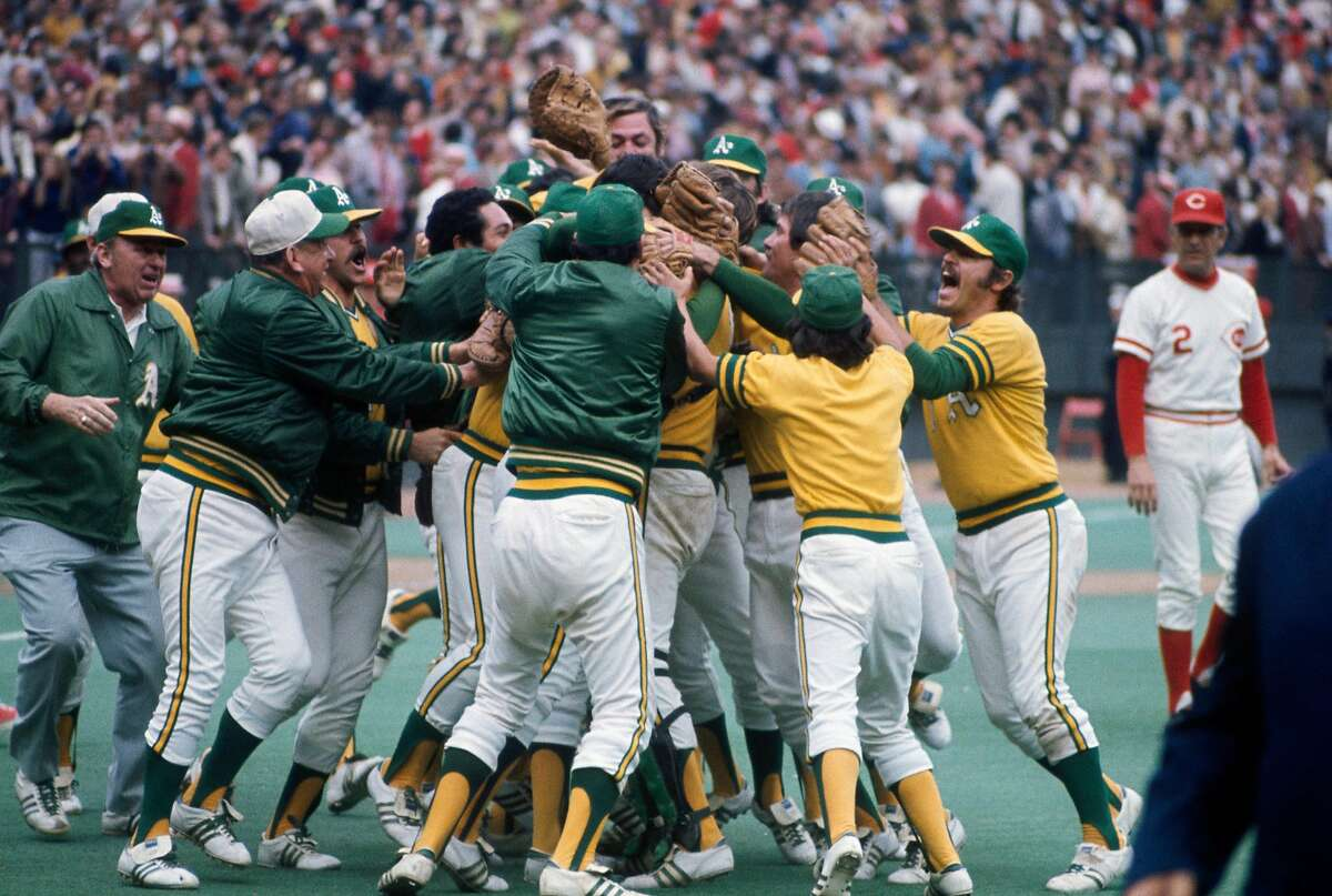 CINCINNATI, OH - OCTOBER 22: Members of the Oakland Athletics celebrate after winning Game 7 of the 1972 World Series against the Cincinnati Reds on October 22, 1972 at Riverfront Stadium in Cincinnati, Ohio. The A's defeated the Red 3-2. (Photo by Focus on Sport/Getty Images)