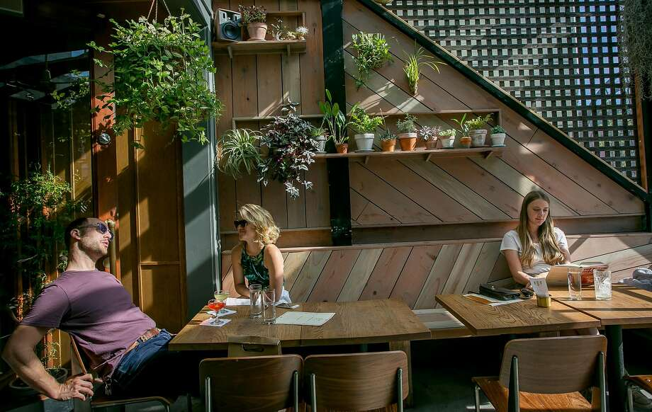 People have drinks on the patio at Horsefeather in S.F. Photo: John Storey, Special To The Chronicle