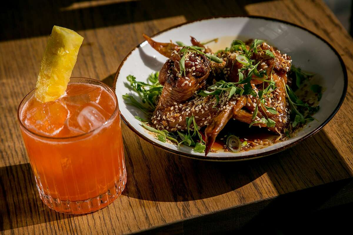 The Red Rooster cocktail with the Chicken Wings at Horsefeather in San Francisco, Calif., is seen on May 28th, 2016.