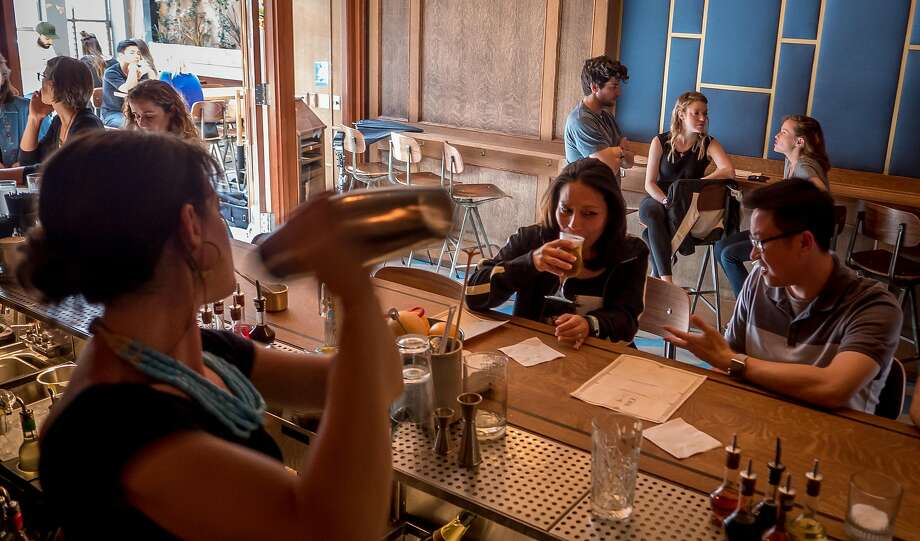Bartender Nora Furst shakes a cocktail at Horsefeather in S.F. Photo: John Storey, Special To The Chronicle