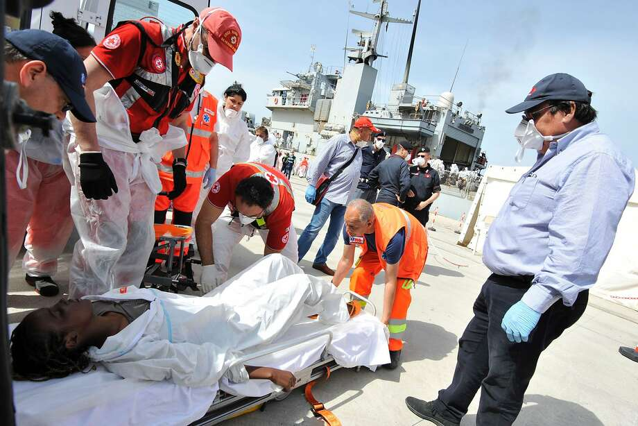 A woman rescued in the Mediterranean receives medical assistance in Reggio Calabria in southern Italy. Photo: GIOVANNI ISOLINO, AFP/Getty Images