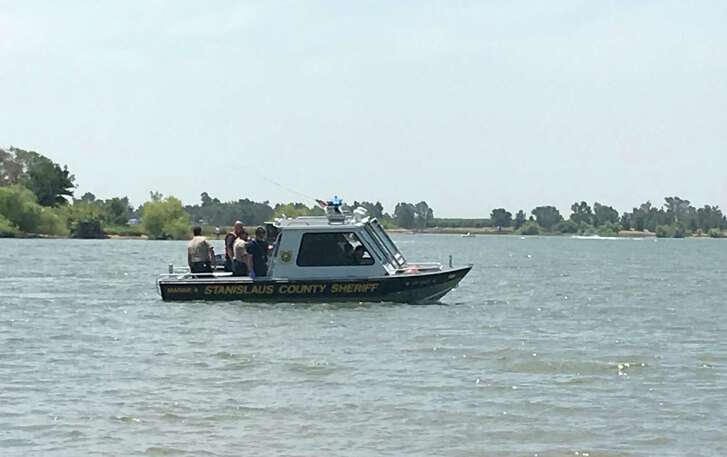 A Stanislaus County Sheriff's patrol boat searches for two missing Oakland teenagers at Woodward Resevoir.