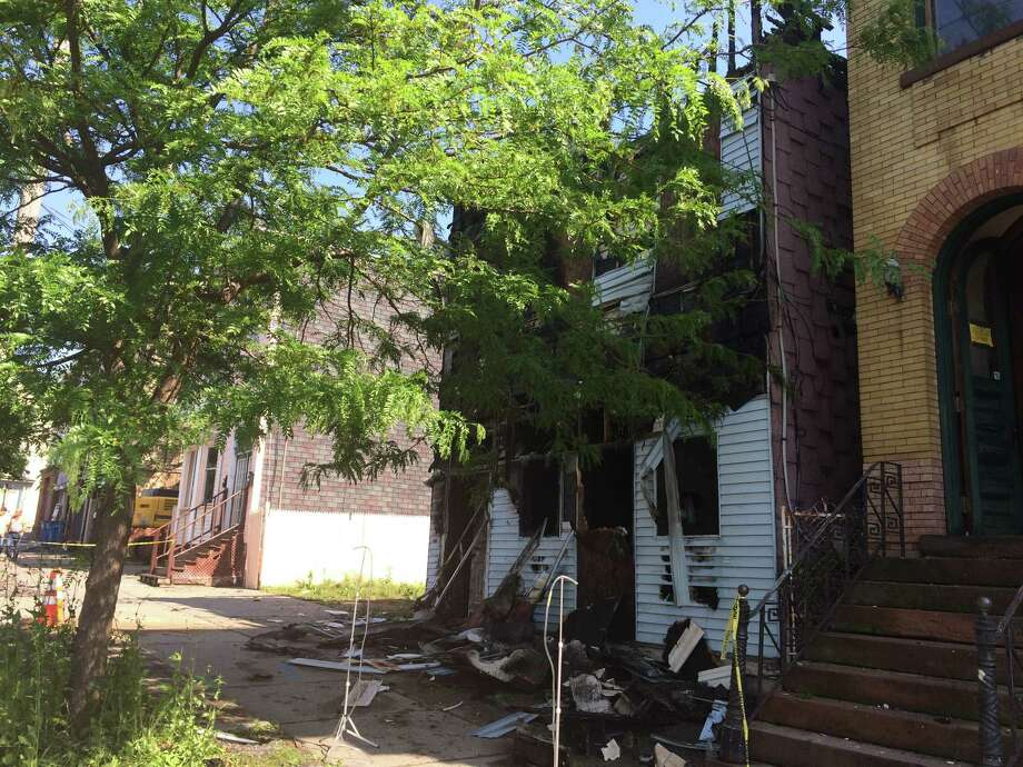 A vacant house at 325 Clinton Ave. was destroyed by fire May 29, 2016 in Albany. (Lauren Stanforth)