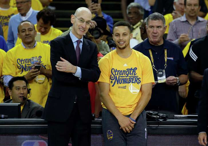 Golden State Warriors' Stephen Curry, right, smiles with NBA Commissioner Adam Silver as Curry was presented with NBA Most Valuable Player award before Game 5 of the team's second-round playoff series against the Portland Trail Blazers on Wednesday, May 11, 2016, in Oakland, Calif. (AP Photo/Marcio Jose Sanchez)