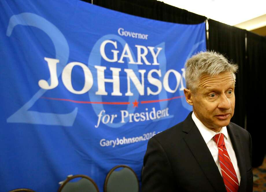Libertarian candidate Gary Johnson proposes replacing federal income and corporate taxes with a national sales tax. Photo: John Raoux, Associated Press