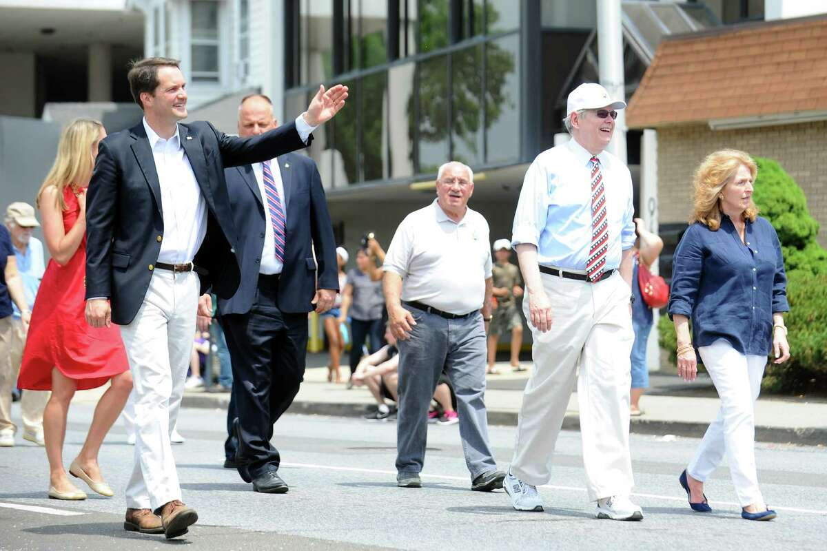 Connecticut Senator Chris Leone, left, and Stamford Mayor David Martin walk down Summer Street during the Memorial Day Parade on Sunday, May 29, 2016.