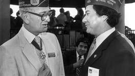 American GI Forum founder Dr. Hector P. Garcia, wearing his Presidential Medal of Freedom, chats with National Chairman Eduard Bernaldez at a party for Garcia in San Antonio, in this 1985 file photo. Garcia, who made his last major local appearance at a July 1993 reception in his honor, was a trailblazer in the U.S. civil rights movement. FILE PHOTO
