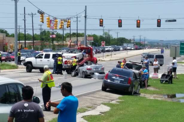 Police and fire units in Leon Valley respond to a 14-vehicle wreck on the Northwest Side, Sunday, May 29, 2016.