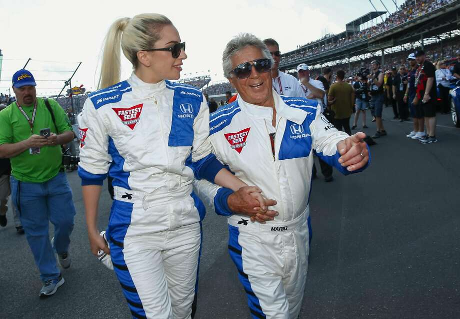 INDIANAPOLIS, IN - MAY 29: Lady Gaga and Mario Andretti walk to the track before start of the Indy 500 at the Indianapolis Motor Speedway on May 29, 2016 in Indianapolis, Indiana. (Photo by Michael Hickey/Getty Images) Photo: Michael Hickey, Getty Images