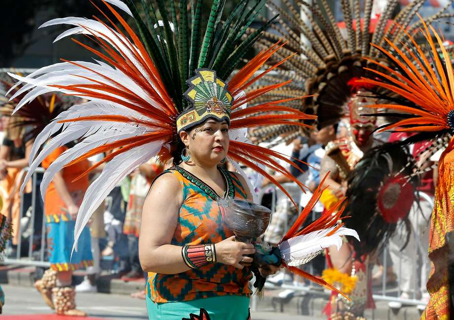 A group of parade participants dressed in traditional garb carry incense while walking down Mission Street during the annual Carnaval parade in San Francisco, California, on Sunday, May 29, 2016. Photo: Connor Radnovich, The Chronicle