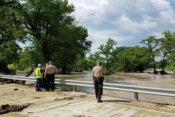 Emergency personnel in recovery efforts along the Guadalupe River near River Bend Road in Kendall County for a woman who died from flooding Sunday morning, May 29, 2016.