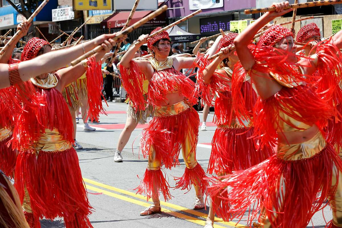 A group of dancers performs with sticks during the annual Carnaval parade in San Francisco, California, on Sunday, May 29, 2016.