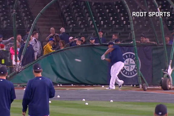 Seattle's Nelson Cruz slugs a home run completely out of Safeco Field during batting practice Saturday.