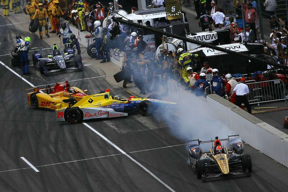 Ryan Hunter-Reay (yellow car) crashes into Andretti Autosport teammate Towsend Bell in the pits. Photo: Chris Graythen