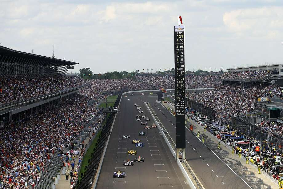 Alexander Rossi leads the pack near the end of the 100th running of the Indianapolis 500. Rossi is the first rookie to win since Helio Castroneves in 2001. Photo: Chris Graythen, Getty Images