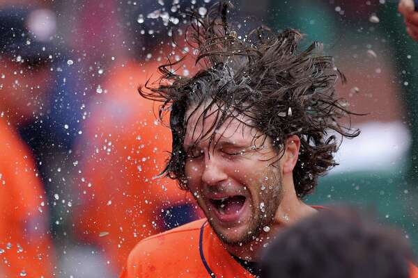 Houston Astros' Jake Marisnick has water and sunflower seed thrown at him in the dugout after hitting a two-run home run during the fifth inning of a baseball game against the Los Angeles Angels, Sunday, May 29, 2016, in Anaheim, Calif. (AP Photo/Mark J. Terrill)