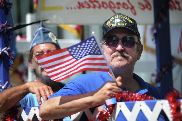 Navy veteran Jim Crowley, of Derby, rides on a float with the Derby Catholic War Veterans in the Ansonia Memorial Day parade on Main Street in Ansonia, Conn. on Sunday, May 29, 2016.