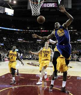 Andre Iguodala (9) is fouled by LeBron James (23) in the second half during Game 4 of the NBA Finals between the Golden State Warriors and the Cleveland Cavaliers at Quicken Loans Arena in Cleveland, Ohio., on Thursday, June 11, 2015.