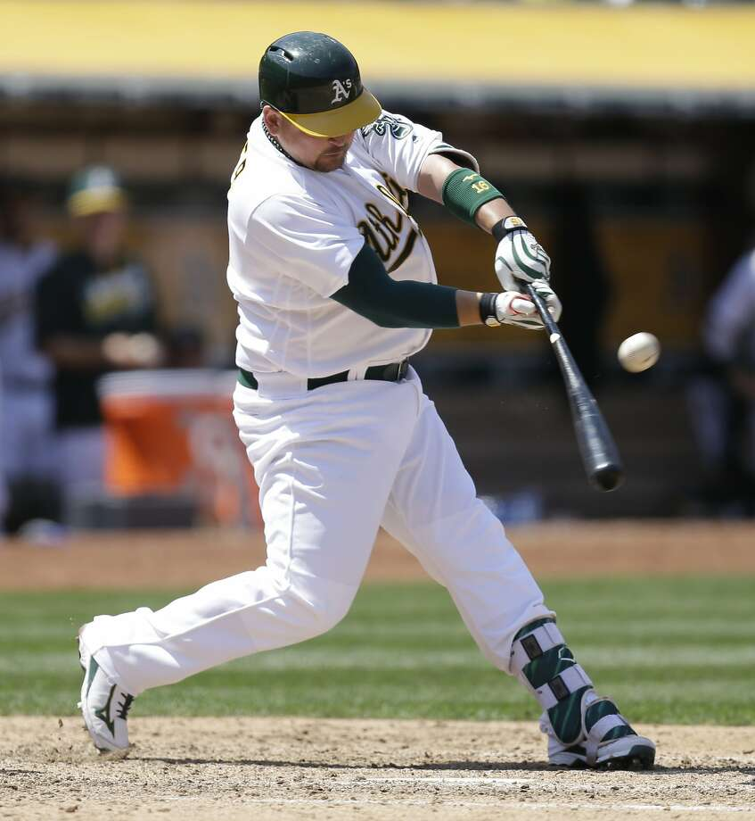 Oakland Athletics' Billy Butler swings for a two run single against the Detroit Tigers in the sixth inning of a baseball game Sunday, May 29, 2016, in Oakland, Calif. (AP Photo/Ben Margot) Photo: Ben Margot, Associated Press
