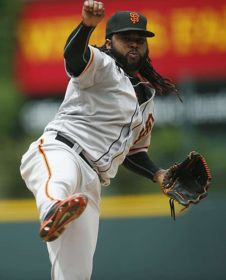 San Francisco Giants starting pitcher Johnny Cueto delivers a pitch to Colorado Rockies' Carlos Gonzalez in the first inning of a baseball game Sunday, May 29, 2016, in Denver. (AP Photo/David Zalubowski)
