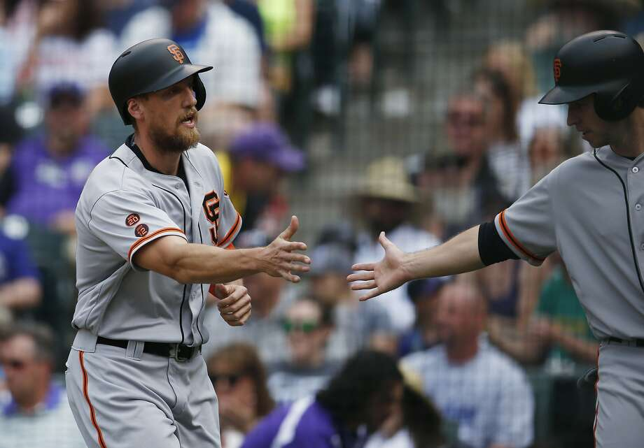 Hunter Pence is congratulated by Buster Posey after scoring on Brandon Belt's double — one of eight hit by the Giants. Photo: David Zalubowski, Associated Press