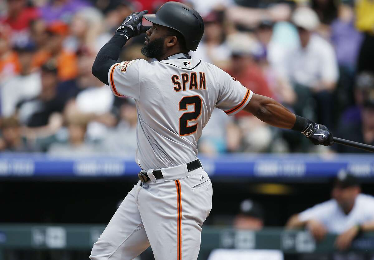 San Francisco Giants' Denard Span follows the flight of his solo home run off Colorado Rockies relief pitcher Chris Rusin to lead off the fourth inning of a baseball game, Sunday, May 29, 2016, in Denver. San Francisco won 8-3. (AP Photo/David Zalubowski)