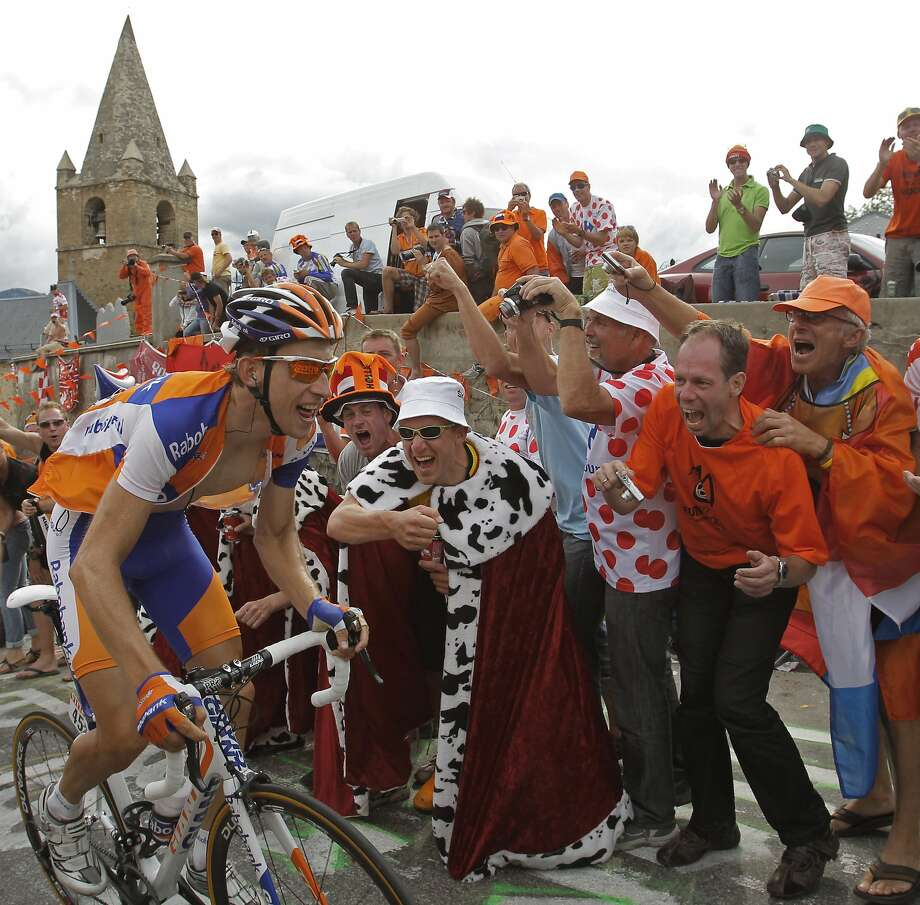 The Alpe d'Huez on the Tour de France course makes for an interesting mix of cyclists and fans, many of whom begin celebrating hours or even days before the riders make appearances. Photo: Christophe Ena, Associated Press