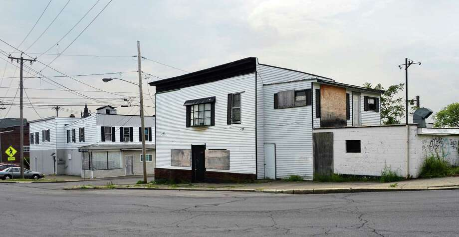 Former bar, right, long closed and targeted by Cohoes Blight initiative at 330 Ontario Street, Friday May 27, 2016 in Cohoes, NY.  (John Carl D'Annibale / Times Union) Photo: John Carl D'Annibale / 20036774A