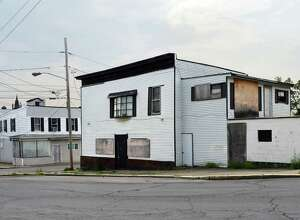 Former bar, right, long closed and targeted by Cohoes Blight initiative at 330 Ontario Street, Friday May 27, 2016 in Cohoes, NY.  (John Carl D'Annibale / Times Union)