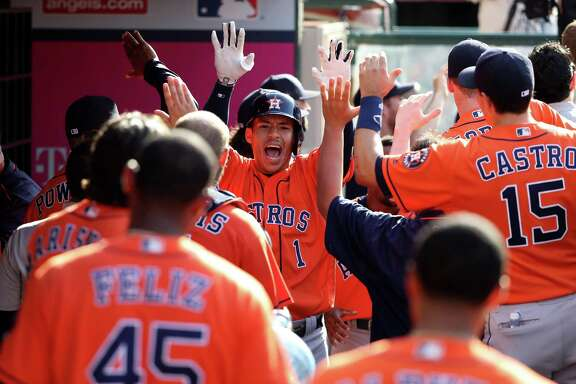 ANAHEIM, CA - MAY 29:  Carlos Correa #1 of the Houston Astros is congratulated in the dugout after hitting a two-run home run during the thirteenth ninth inning of a game against the Los Angeles Angels of Anaheim at Angel Stadium of Anaheim on May 29, 2016 in Anaheim, California.