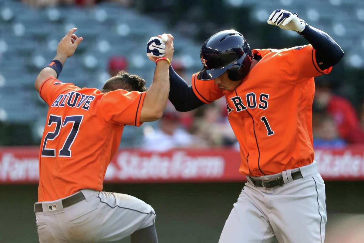May 29: Astros 8, Angels 6 (13 innings) ANAHEIM, CA - MAY 29: Carlos Correa #1 is congratulated by Jose Altuve #27 of the Houston Astros after hitting a three-run home run during the thirteenth inning of a game against the Los Angeles Angels of Anaheim at Angel Stadium of Anaheim on May 29, 2016 in Anaheim, California.