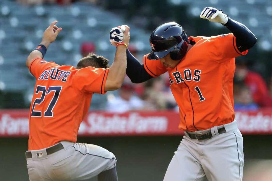 May 29: Astros 8, Angels 6 (13 innings)ANAHEIM, CA - MAY 29:  Carlos Correa #1 is congratulated by Jose Altuve #27 of the Houston Astros after hitting a three-run home run during the thirteenth inning of a game against the Los Angeles Angels of Anaheim at Angel Stadium of Anaheim on May 29, 2016 in Anaheim, California. Photo: Sean M. Haffey, Getty Images / 2016 Getty Images