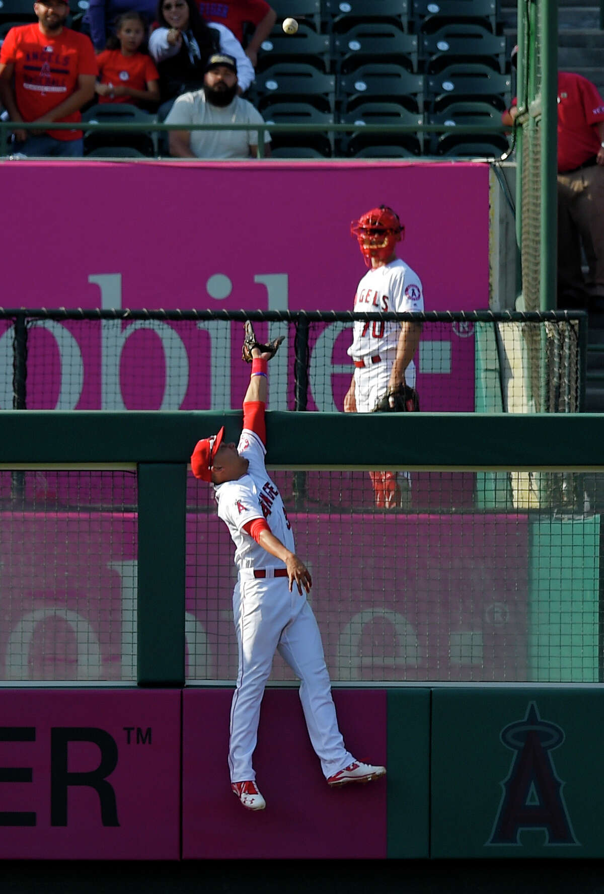 Los Angeles Angels left fielder Rafael Ortega can't reach a ball hit for a three-run home run by Houston Astros' Carlos Correa during the 13th inning of a baseball game, Sunday, May 29, 2016, in Anaheim, Calif. (AP Photo/Mark J. Terrill)