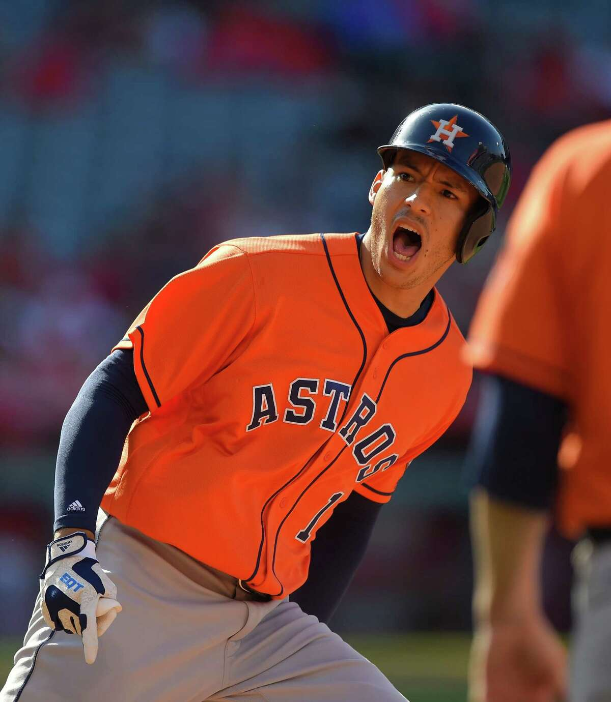 Houston Astros' Carlos Correa celebrates as he rounds first after hitting a three-run home run during the 13th inning of a baseball game against the Los Angeles Angels, Sunday, May 29, 2016, in Anaheim, Calif. The Astros won 8-6. (AP Photo/Mark J. Terrill)