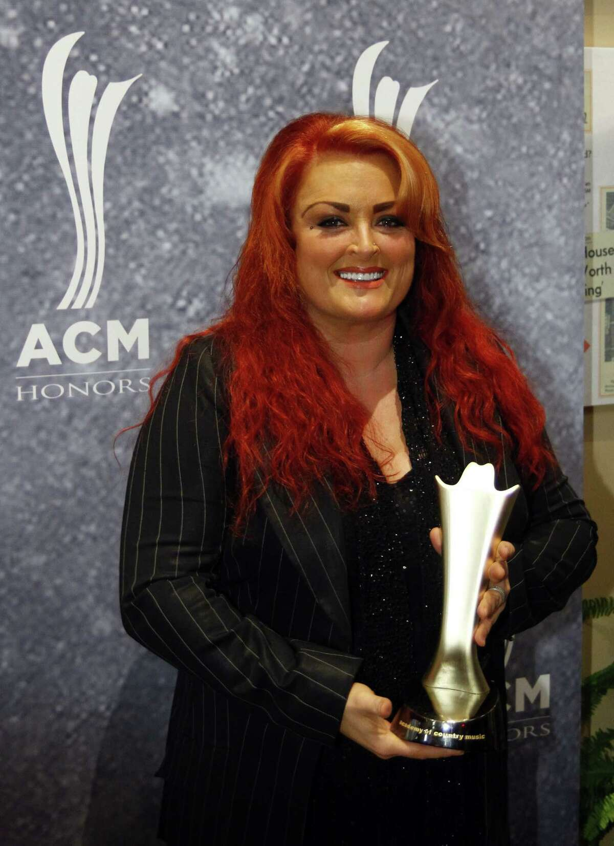 Wynonna Judd arrives at the ACM Honors at the Ryman Auditorium on Tuesday, Sept. 10, 2013 in Nashville, Tenn. (Photo by Wade Payne/Invision/AP) ORG XMIT: TNWP102