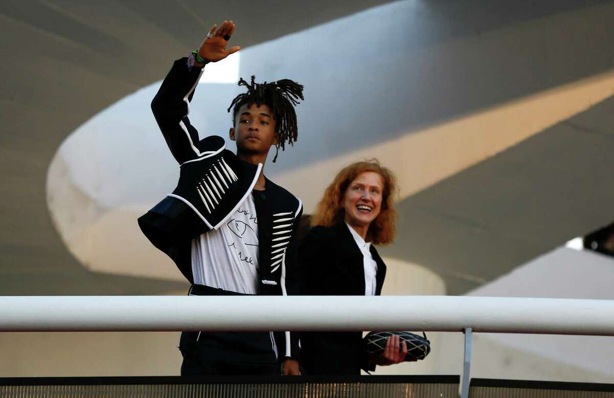 Jaden Smith waves to fans from a ramp of the Contemporary Art Museum where he was attending the Louis Vuitton Cruise 2017 collection fashion show, in Niteroi, Brazil, Saturday, May 28, 2016. The elite of the fashion world flocked to Brazil, defying an outbreak of the Zika virus, an economic meltdown and the profound political crisis afflicting the country to attend a runway show Saturday by revered French label. (AP Photo/Leo Correa) ORG XMIT: XLC115