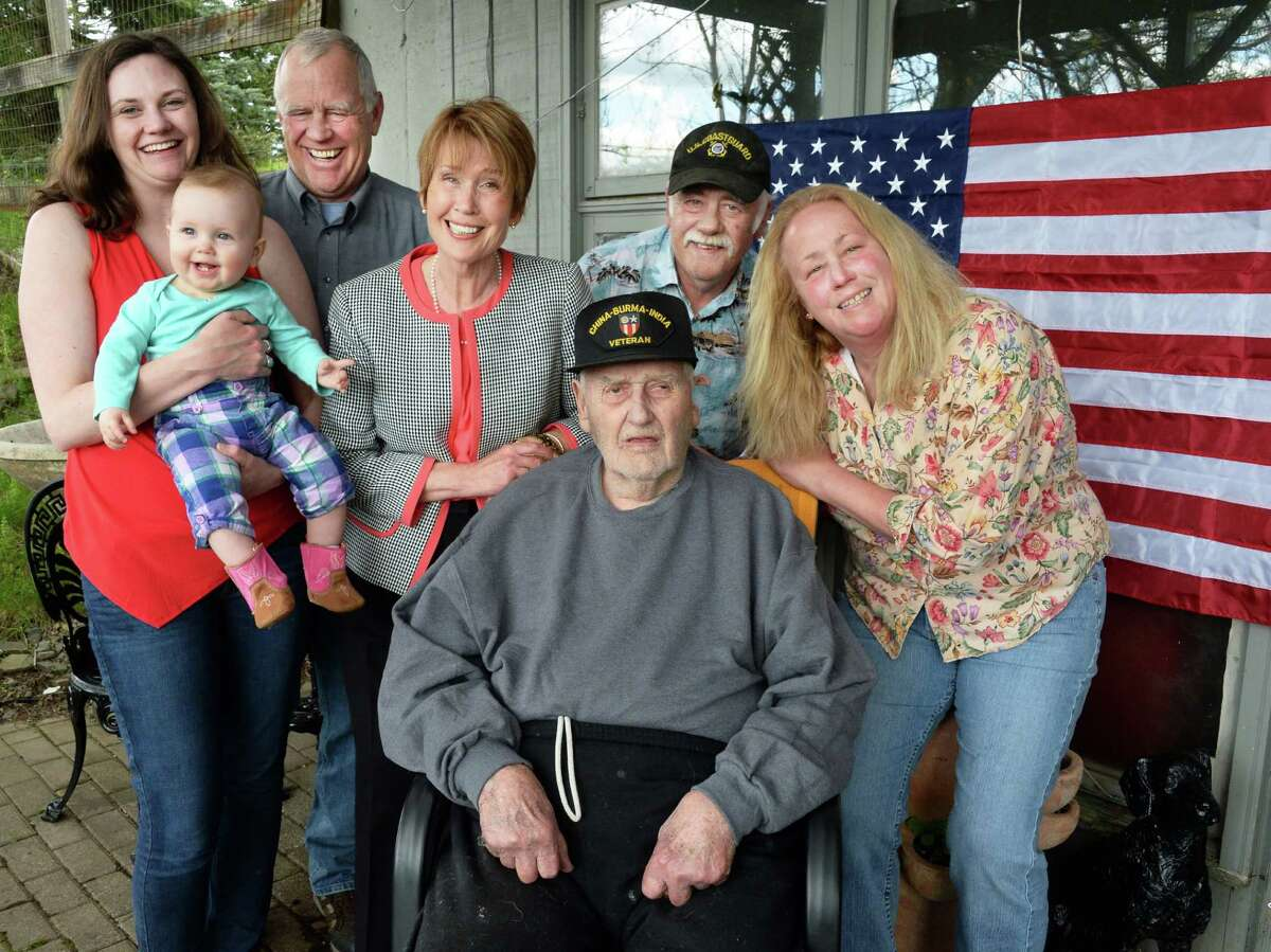 World War II veteran of the 14th Army Air Force's Flying Tigers Jack Gordon, seated, with family members, from left, granddaughter Sarah Gordon, great-granddaughter Ellen Brand, son Sandy Gordon, daughter Muriel Gordon, son John Gordon and daughter Pamela Christensen at his rural home Thursday May 19, 2016 in Broome, NY. (John Carl D'Annibale / Times Union)