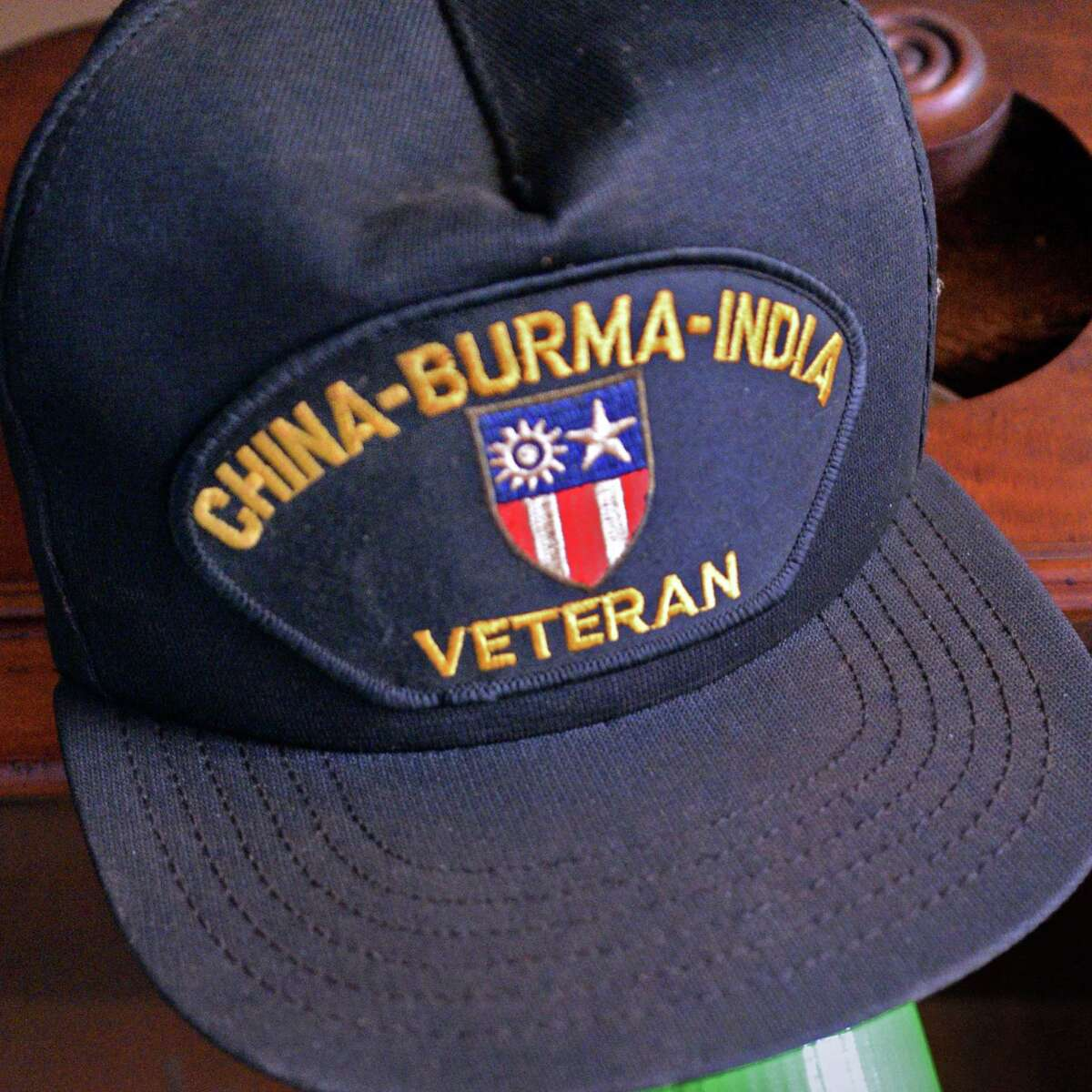 A China-Burma-India veteran's cap belonging World War II member of the 14th Army Air Force's Flying Tigers Jack Gordon, 95, in the study of his rural home Thursday May 19, 2016 in Broome, NY. Gordon was a senior navigator on a C47 flying over