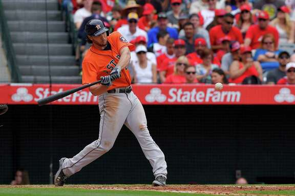 Jake Marisnick connects on a two-run homer off Angels starter Nick Tropeano in the fifth inning Sunday. It was the first home run by an Astros center fielder this season.