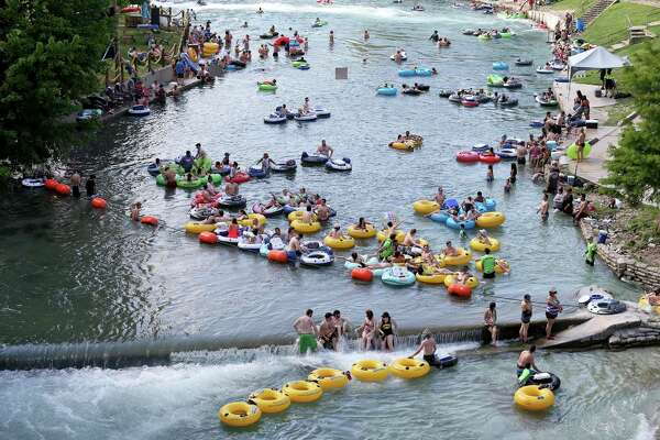 People enjoy the tube chute area in Prince Solms Park on the Comal River in 2016 in New Braunfels.
