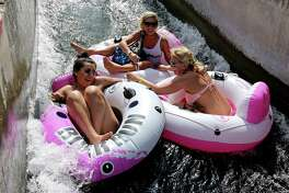 Tubers enjoy the tube chute in Prince Solms Park on the Comal River Sunday May 29, 2016 in New Braunfels, Tx.