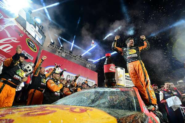 CHARLOTTE, NC - MAY 29:  Martin Truex Jr., driver of the #78 Bass Pro Shops/Tracker Toyota, celebrates in Victory Lane after winning the NASCAR Sprint Cup Series Coca-Cola 600 at Charlotte Motor Speedway on May 29, 2016 in Charlotte, North Carolina.  (Photo by Jared C. Tilton/Getty Images) *** BESTPIX ***